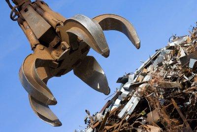 Crane grabbing metal